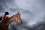 Female jockey riding horse