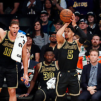 30 March 2018: Los Angeles Lakers guard Josh Hart (5) takes a jump shot next to Los Angeles Lakers center Brook Lopez (11) during the Milwaukee Bucks 124-122 victory over the LA Lakers, at the Staples Center, Los Angeles, California, USA.