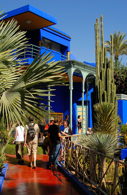 Tourists take in the tropical gardens at Jardin Majorelle in Marrakech. This former home to French painter Jacques Majorelle is now owned by fashion designer Yves Saint Laurent and contains the Museum of Islamic Art.