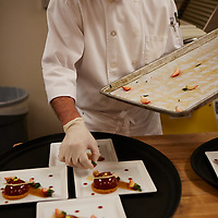 Event food services preparing strawberry tarts .