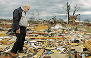 Photo by Gary Cosby Jr.    James Devaney searches through the debris of his daughter's home on County Rd. 183 in the Aldridge Grove community of Lawrence County, AL Wednesday, February 6, 2008.  Devaney's daughter Becky Coleman was killed along with her son Gerrick and her husband Greg when the tornado hit at 3:06 a.m.