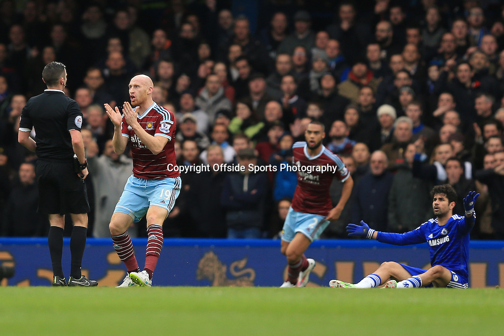 26 December 2014 - Barclays Premier League - Chelsea v West Ham - James Collins of West Ham protests as he is booked for a foul on Diego Costa of Chelsea - Photo: Marc Atkins / Offside.