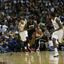 Mar 22, 2014; New Orleans, LA, USA; Miami Heat forward LeBron James (6) drives down the court against the New Orleans Pelicans during the second half of a game at the Smoothie King Center. The Pelicans defeated the Heat 105-95. Mandatory Credit: Derick E. Hingle-USA TODAY Sports