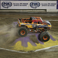 Strait Jacket driven by Kevin King is seen during the Monster Jam big truck event at the Citrus Bowl in Orlando, Florida on Saturday, January 25, 2014. (AP Photo/Alex Menendez)