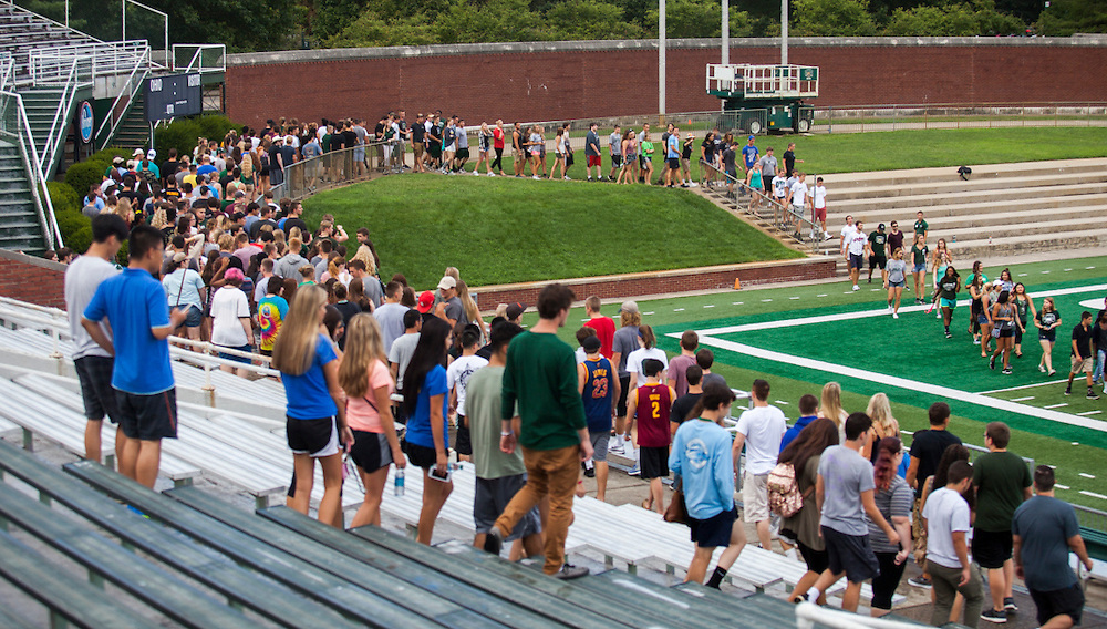 First-year students walk onto the football field at Peden Stadium for the Class of 2020 photo on Saturday, August 20, 2016. © Ohio University / Photo by Kaitlin Owens