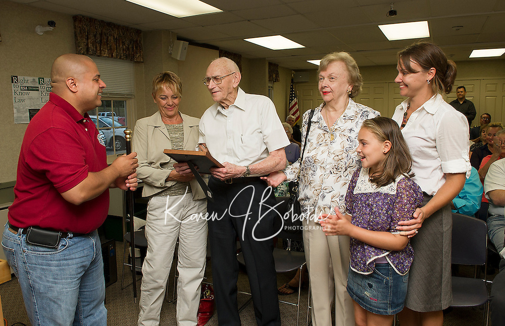 David Bickford accepts the Boston Post Cane from Gus Benevides prior to Wednesday evenings Selectmans meeting at the Gilford Town Hall.  Five generations surrounding Bickford are his granddaughter Alicia Gorrell, daughter Evelyn Firth, great grand daughter Breinn Daigneault and great great granddaughter Lydia Jordan.   (Karen Bobotas/for the Laconia Daily Sun)