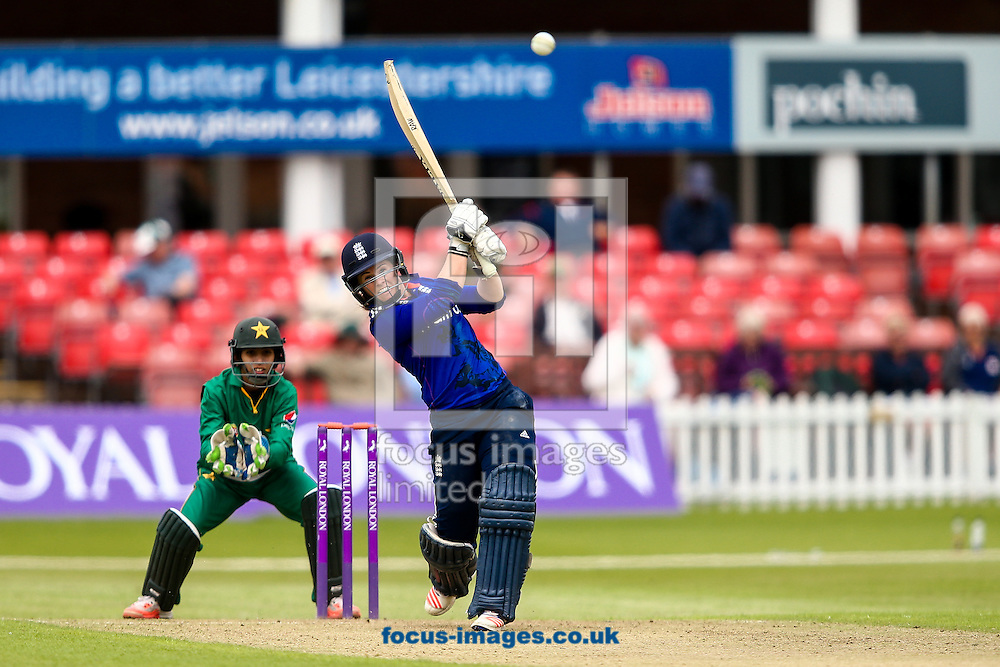 Tammy Beaumont of England (right) hits the ball to the boundary for four as Sidra Nawaz of Pakistan looks on during the Royal London One Day Series match at Fischer County Ground, Leicester<br /> Picture by Andy Kearns/Focus Images Ltd 0781 864 4264<br /> 21/06/2016