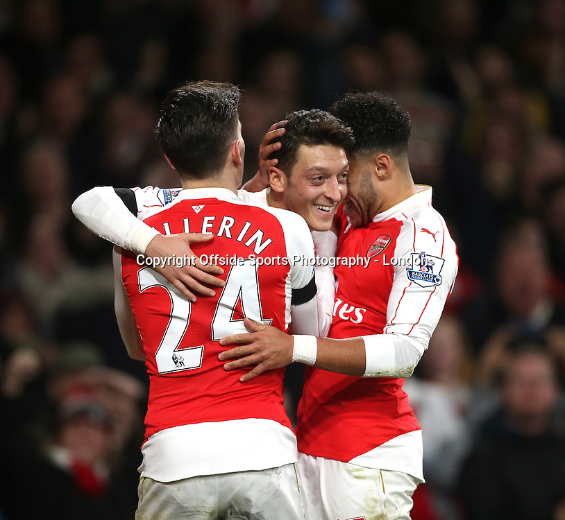 28 December 2015 - Premier League - Arsenal v AFC Bournemouth :<br /> Mesut Ozil (centre) celebrates after scoring the second goal for Arsenal.<br /> Photo: Mark Leech