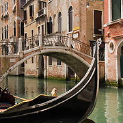 Gondola tied up along Rio di S. Luca with Ponte de S. Paternian bridge over Rio di S. Luca, Venice, Italy<br />