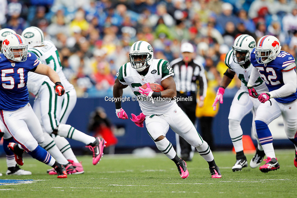 New York Jets running back LaDainian Tomlinson (21) runs the ball for an 18 yard gain in the second quarter during a NFL week 4 football game against the Buffalo Bills on Sunday, October 3, 2010 in Orchard Park, New York. The Jets won the game 38-14. (©Paul Anthony Spinelli)