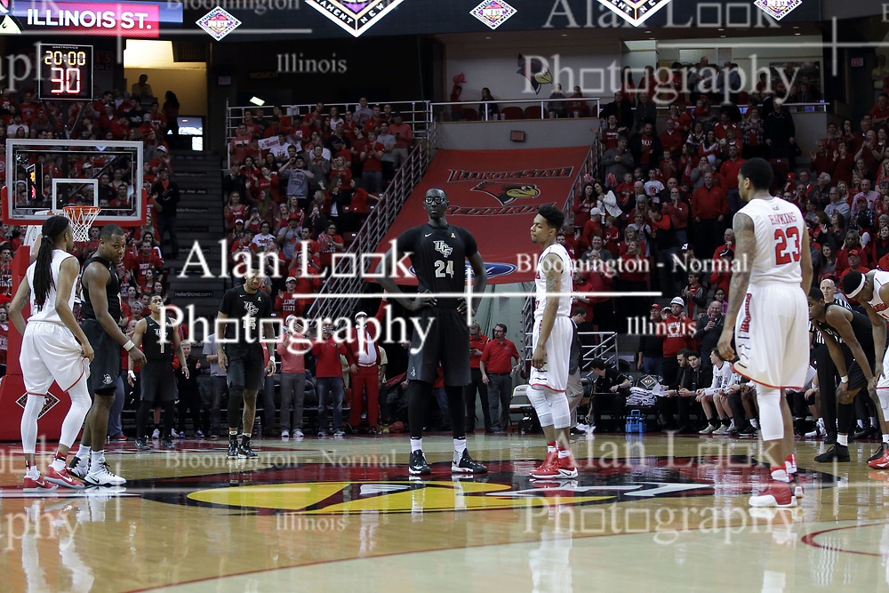 20 March 2017:  Tacko Fall and Phil Fayne(10) prepare for the tip off during a College NIT (National Invitational Tournament) 2nd round mens basketball game between the UCF (University of Central Florida) Knights and Illinois State Redbirds in  Redbird Arena, Normal IL