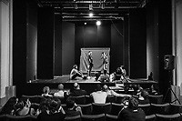"""NAPLES, ITALY - 30 JULY 2018: The young actors of the collective """"Nuovo Teatro Sanità"""" (New Sanità Theatre) are seen here during a rehearsal in the Sanità neighborhood, in Naples, Italy, on July 30th 2018.<br /> <br /> In 2017 the 17-year-old innocent victim Genny Cesarano was shot and killed by stray bullet  in cross fire between 2 rival gangs vying for territorial control in the Sanità neighborhood.<br /> The  isolation of the neighborhood Sanità over the years provided an ideal location for the Camorra to expand their illicit activities and profit from soaring unemployment rates and economic instability,<br /> <br /> After the first death threats of 2006 by the Casalese clan , a cartel of the Camorra, which he denounced in his exposé and in the piazza of Casal di Principe during a demonstration in defense of legality, Roberto Saviano was put under a strict security protocol. Since 2006 Roberto Saviano has lived under police protection.<br /> <br /> Saviano's latest novel """"The Piranhas"""", which tells the story of the rise of  a paranza (or Children's gang) and it leader Nicolas, will be released in the United States on September 4th 2018."""