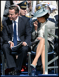 Image ©Licensed to i-Images Picture Agency. 06/06/2014. Bayeux, France, Samantha Cameron puts lipstick on while join The Prime Minister David Cameron as they join HM The Queen and The Duke of Edinburgh accompanied by The Prince of Wales and The Duchess of Cornwall attend a service of Remembrance at the Commonwealth War Graves Cemetery at Bayeux, Normandy, France,  on the 70th anniversary of D-Day.  Picture by Andrew Parsons / i-Images