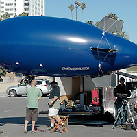 Crew from GOBLIMPS.COM prepare to launch their blimp at Santa Monica Beach on Saturday, November 13, 2010.