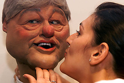 Sothebys to sell cast of satirical TV show Spitting Image. Photo shows Mady Delucia from Sothebys giving President Clinton a little kiss and as you can see from Clinton's eyes he is enjoying every minute of it, July 7, 2000. Photo by Andrew Parsons / i-images...spain out