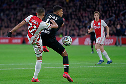 Hakim Ziyech #22 of Ajax and Owen Wijndal #15 of AZ Alkmaar in action during the Dutch Eredivisie match round 25 between Ajax Amsterdam and AZ Alkmaar at the Johan Cruijff Arena on March 01, 2020 in Amsterdam, Netherlands