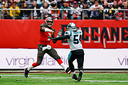 Tampa Bay Buccaneers QuarterbackJ ameis Winston (3) passes under pressure from Carolina Panthers Linebacker Shaq Thompson (54) during the International Series match between Tampa Bay Buccaneers and Carolina Panthers at Tottenham Hotspur Stadium, London, United Kingdom on 13 October 2019.