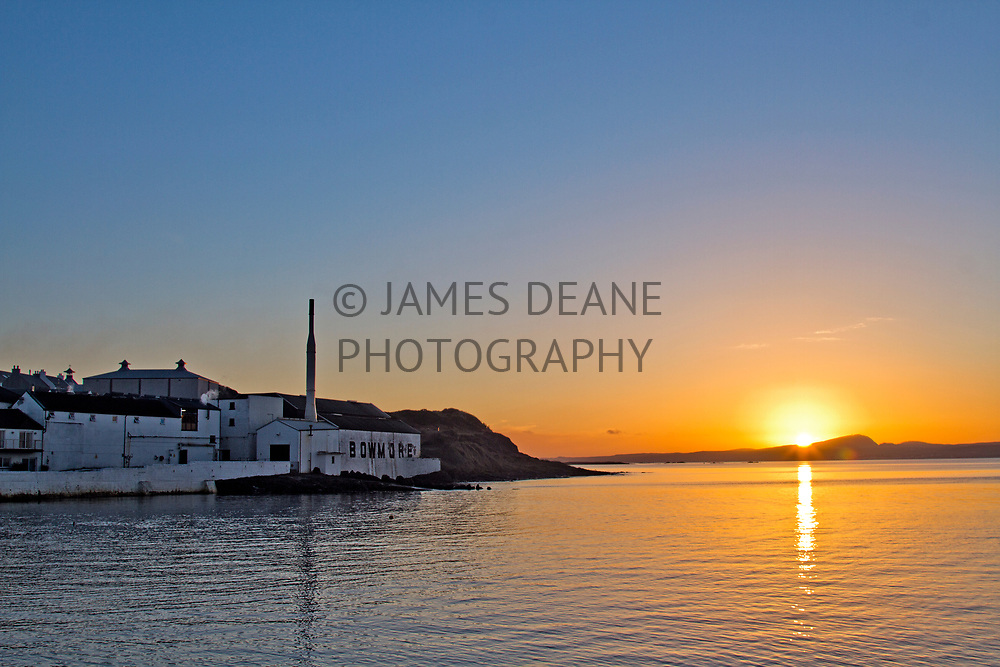 Sunset over Loch Indaal showing Bowmore Distillery