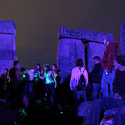 Sundown to sunrise on Summer Solstice celebration at Stonehenge.