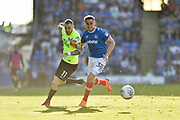 Peterborough United Midfielder, Marcus Maddison (11) and Portsmouth Defender, Brandon Haunstrup (38) during the EFL Sky Bet League 1 match between Portsmouth and Peterborough United at Fratton Park, Portsmouth, England on 5 May 2018. Picture by Adam Rivers.