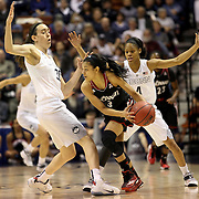 Ana Owens, Cincinnati, defended by Breanna Stewart, and Moriah Jefferson, (right), UConn, during the UConn Vs Cincinnati Quarterfinal Basketball game at the American Women's College Basketball Championships 2015 at Mohegan Sun Arena, Uncasville, Connecticut, USA. 7th March 2015. Photo Tim Clayton