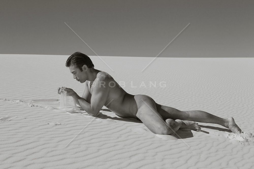naked man on a sand dune in White Sands, NM