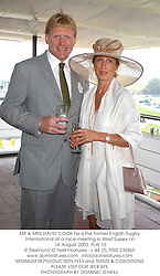 MR & MRS DAVID COOK he is the former English Rugby International at a race meeting in West Sussex on 1st August 2003.PLW 10