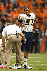 Oct 21, 2011; Syracuse NY, USA;  West Virginia Mountaineers defensive lineman Julian Miller (97) is attended to by medical staff after sustaining an injury against the Syracuse Orange during the third quarter at the Carrier Dome.  Syracuse defeated West Virginia 49-23. Mandatory Credit: Jason O. Watson-US PRESSWIRE