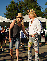 Michelle Easter and Paul Santo head towards the VIP station for an evening array of bands followed by Steven Tyler at Laconia Fest Wednesday evening.  (Karen Bobotas/for the Laconia Daily Sun)