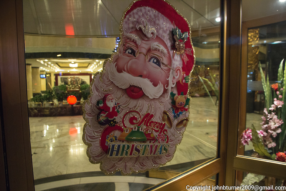 Christmas decoration (Santa Claus) at the Jiao Tong Da Sha Business Hotel, Taiyuan, Shanxi Province, China