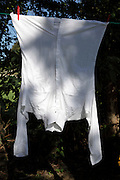 washing line with white shirt hanging to dry
