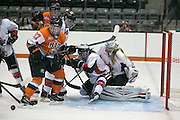 RIT's Jess Paton (#27) chases a loose puck during an exhibition game at RIT's Gene Polisseni Center on Monday, September 29, 2014.
