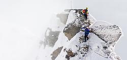 THEMENBILD - Zwei Bergsteiger am Kleinglockner. Der Großglockner ist mit 3798 m ü.A. der höchste Berg Österreichs und ein beliebtes Ziel zahlreicher Bergsteiger. Er ist in der Glocknergruppe in den Hohen Tauern. Aufgenommen am 11.10.2014 in Tirol, Österreich // Mountaineers on Kleinglockner. Grossglockner is the highest mountain of austria and is located in the Hohe Tauern mountain range which is part of the central eastern alps. Tyrol, Austria on 2014/10/11. EXPA Pictures © 2014, PhotoCredit: EXPA/ Michael Gruber
