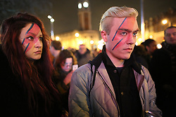 © Licensed to London News Pictures. 11/01/2016. London, UK. Fans gather outside the Ritzy cinema in Brixton in tribute to David Bowie. The Death of David Bowie, who was born in Brixton, has been announced today.  Photo credit: Peter Macdiarmid/LNP