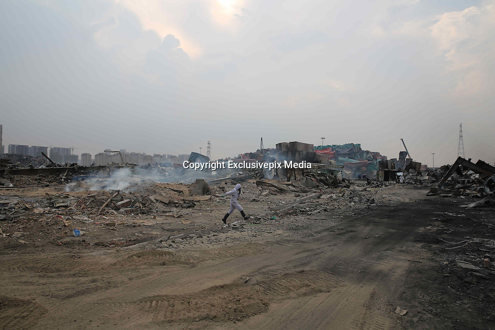 TIANJIN, CHINA - AUGUST 24: (CHINA OUT) <br /> <br /> Chemical-defence Soldiers Detect Toxic Substance<br /> <br /> A soldier of a PLA chemical-defence unit works at Tianjin blasts scene on August 26, 2015 in Tianjin, China. The death toll from the Tianjin warehouse explosions two weeks ago has risen to 139, and 34 others remain missing, rescue authorities said on Wednesday.<br /> ©Exclusivepix Media