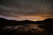 Medano Creek flows beneath the night skies in Great Sand Dunes National Park and Preserve, Colorado.