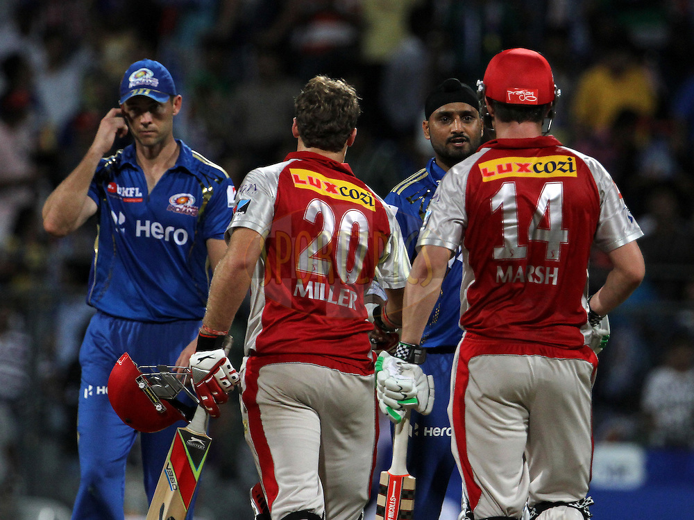Mumbai Indian captain Harbhajan Singh shake hands with Kings XI Punjab player Shaun Marsh and Kings XI Punjab player after the match 28 of the Indian Premier League ( IPL) 2012  between The Mumbai Indians and the Kings X1 Punjab held at the Wankhede Stadium in Mumbai on the 22nd April 2012..Photo by: Vipin Pawar/IPL/SPORTZPICS