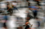 An abstract view of blurred people moving along a street, on 18th June 2002, in London, England.