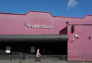 An elderly ladt walks past Wonderland, a former nightclub in Sutton, south London, on 2nd October 2019, in Sutton, London, England