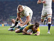 England's Captain Chris Robshaw was not able to stop Australia's fly half Bernard Foley from scoring Australia's first try during the Rugby World Cup Pool A match between England and Australia at Twickenham, Richmond, United Kingdom on 3 October 2015. Photo by Matthew Redman.