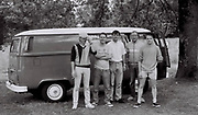 Friends pose in front of VW Camper van in a campsite, UK, 1985