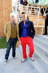 Left to right, NICKY HASLAM and ANDREAS SIEGFRIED at a party at the Serpentine Gallery, Kensington Gardens, London to unveil their summer Pavilion designed by Frank Gehry on 20th July 2008.<br /> <br /> NON EXCLUSIVE - WORLD RIGHTS