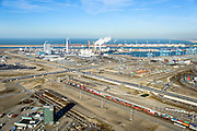 Nederland, Zuid-Holland, Rotterdam, 18-02-2015; Tweede Maasvlakte (MV2). Europaweg en Emplacement Maasvlakte West (Rail Terminal West), in beheer bij Keyrail, exploitant Betuweroute. Zicht op de elektriciteitscentrales van E.ON., APM Terminals Rotterdam, ECT.<br /> <br /> Emplacement Maasvlakte West (West Rail Terminal) and  next to the Hartelharbour  the Emplacement Maasvlakte East. Managed by Keyrail, operator Betuweroute.<br /> <br /> luchtfoto (toeslag op standard tarieven);<br /> aerial photo (additional fee required);<br /> copyright foto/photo Siebe Swart