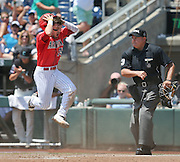 OMAHA -- 6/30/2016: Arizona's Cody Ramer (13) reacts to being tagged out at home by Coastal Carolina catcher David Parrett (12) in the bottom of the third inning. Coastal Carolina played Arizona in game three of the College World Series Finals at TD Ameritrade Park in Omaha, Nebraska, on June 30, 2016. MATT DIXON/THE WORLD-HERALD