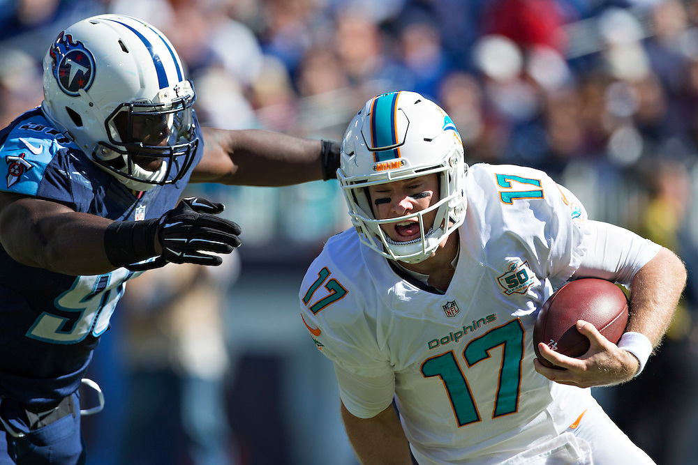 NASHVILLE, TN - OCTOBER 18:  Ryan Tannehill #17 of the Miami Dolphins runs the ball against the Tennessee Titans at LP Field on October 18, 2015 in Nashville, Tennessee.  The Dolphins defeated the Titans 38-10.  (Photo by Wesley Hitt/Getty Images) *** Local Caption *** Ryan Tannehill