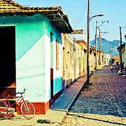 A typical street scene in the historical town of Trinidad, Cuba.<br />