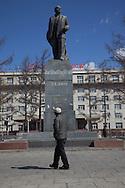 Mongolia. Ulaanbaatar. pedestrians walking in front of lenin statue on peace avenuecity life in Ulan Baatar ULN - Mongolia