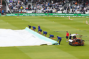 The groundstaff shaking the water before rolling up the covers on the wicket as the rain stops with and inspection due at 11:40am during the International Test Match 2019 match between England and Australia at Lord's Cricket Ground, St John's Wood, United Kingdom on 18 August 2019.