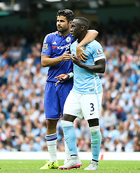 Diego Costa of Chelsea puts his arm around Bacary Sagna of Manchester City  - Mandatory byline: Matt McNulty/JMP - 07966386802 - 16/08/2015 - FOOTBALL - The Etihad Stadium -Manchester,England - Manchester City v Chelsea - Barclays Premier League