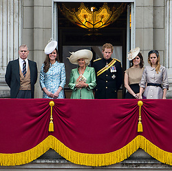 © London News Pictures. 13/06/2015. London, UK. L to R Prince Andrew, Duke of York, Catherine, Duchess of Cambridge, Camilla, Duchess of Cornwall, Prince Harry, Princess Eugenie of York and Princess Beatrice of York . Members of the royal family on the balcony at  Buckingham Palace during the annual Trooping the Colour Ceremony in central London. The event marks the queens official birthday. .Photo credit: Ben Cawthra/LNP